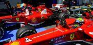Fernando Alonso y Felipe Massa en el parque cerrado de Nürburgring