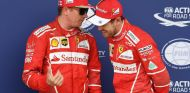 Kimi Räikkönen y Sebastian Vettel durante el pasado GP de Gran Bretaña - SoyMotor.com