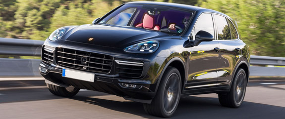 2015-porsche-cayenne-turbo-front-three-quarter-view-in-motion-5.jpg